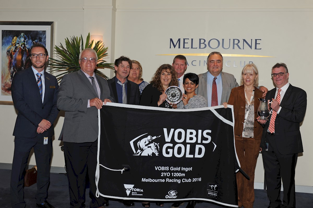 Valliano's owners accept trophies for the VOBIS Gold Ingot  (pic Brett Holburt-Racing Photos)